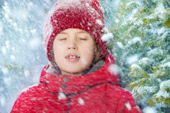 Portrait of boy with closed eyes and falling snow Royalty Free Stock Photos