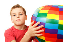 Portrait of boy with colorful inflatable ball Stock Photo