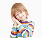 Portrait of a Boy in Colorful Shirt with Head on his Hands Royalty Free Stock Image