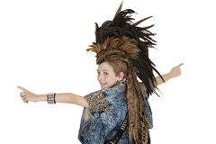 Portrait of boy in costume with headdress looking back over white background Stock Photo