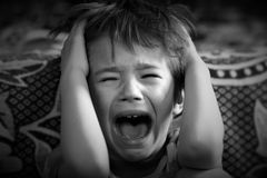 Portrait of a boy crying out loud Royalty Free Stock Images