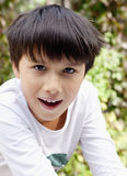 Portrait of a Boy with Dark Hair. Outdoors Royalty Free Stock Image