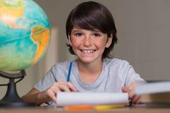 Portrait of boy doing homework Stock Photos