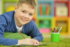 Little boy drawing with pencil. Portrait of a boy drawing with pencil Royalty Free Stock Photo