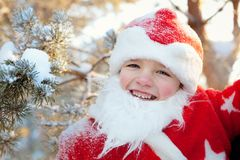 Portrait of boy dressed as Santa Stock Images
