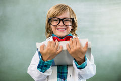 Portrait of boy dressed as scientist in classroom Stock Photography