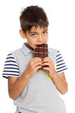 Portrait boy eats chocolate Royalty Free Stock Image