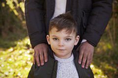 Portrait Of Boy With Father Standing In Autumn Garden Royalty Free Stock Images