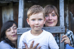 Portrait of a boy of five years, with her mother and older sister. Stock Photo