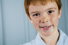 Portrait boy with ginger hair and freckles smiling Stock Photography