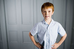 Portrait boy with ginger hair indoor Royalty Free Stock Photography