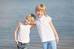 Portrait of a boy and girl on the beach Stock Images