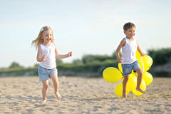 Portrait of a boy and girl on the beach Stock Photo