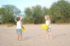 Portrait of a boy and girl on the beach Stock Photography
