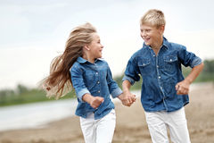 Portrait of a boy and girl on the beach Royalty Free Stock Images