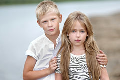 Portrait of a boy and girl on the beach Stock Photos