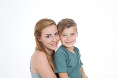 Portrait of boy and girl on empty background. Brother and sister smiling together happy Stock Photo