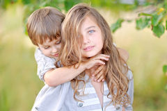 Portrait of a boy and girl on the field Royalty Free Stock Photos