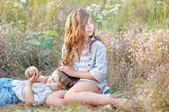 Portrait of a boy and girl on the field Stock Photos