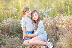 Portrait of a boy and girl on the field Royalty Free Stock Photo