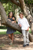 Portrait of a boy and a girl near the tree. Happy young couple near the tree Royalty Free Stock Image