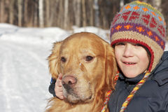 Portrait of boy and golden retriever Royalty Free Stock Photography