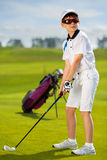 Portrait of boy golfer. In golf course at summer day Royalty Free Stock Photography