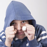 Portrait of a boy with grimace. Close up photo Royalty Free Stock Photos