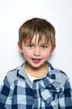 Child making funny faces. Portrait of a boy having fun, making faces and funny expressions Royalty Free Stock Images