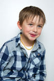 Child making funny faces. Portrait of a boy a having fun, making faces and funny expressions Stock Photography