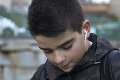 Portrait of a boy. With headphones outdoors royalty free stock photo