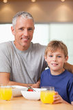 Portrait of a boy and his father having breakfast Royalty Free Stock Images
