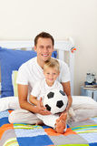 Portrait of a boy and his father at home Stock Photos