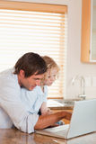 Portrait of a boy and his father using a laptop together Royalty Free Stock Photos