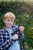 Portrait of Boy Holding an Air Pistol Royalty Free Stock Images