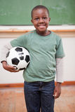 Portrait of boy holding a ball Royalty Free Stock Image