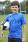 Portrait Of Boy Holding Ball On School Rugby Pitch Stock Photos