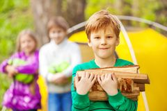 Portrait of boy holding the wood for bonfire Royalty Free Stock Photo