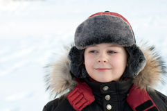Portrait of a boy in jacket with fur Royalty Free Stock Photography