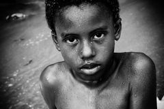 Boy on caribbean beach. Portrait of a boy just in from the ocean Stock Images