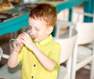 Portrait of boy kid drinking glass of water Royalty Free Stock Image