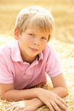 Portrait Of Boy Laying In Summer Harvested Field Stock Photos