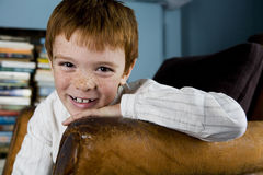 portrait boy leaning on arm of sofa Royalty Free Stock Photography
