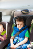 Portrait of boy listening to music in a car trip stock photography