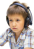 Portrait of boy listening to music with earphones Stock Images