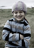 Portrait of a Boy. Little Boy on a Rock Royalty Free Stock Photo
