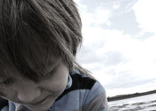 Portrait of a Boy. Little Boy on a Rock Royalty Free Stock Image