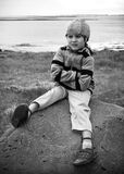 Portrait of a Boy. Little Boy on a Rock Royalty Free Stock Images