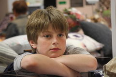 Boy looking bored while out shopping Stock Photos