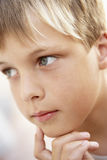 Portrait Of Boy Looking Pensive Royalty Free Stock Photo